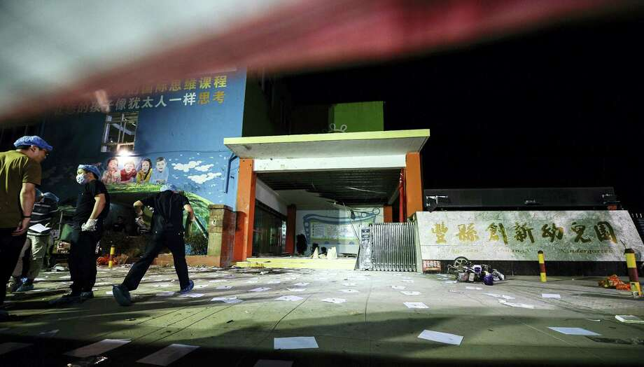 In this photo released by China's Xinhua News Agency, investigators work early Friday, June 16, 2017, at the scene of an explosion outside a kindergarten in Fengxian County in eastern China's Jiangsu Province. Several people were killed and dozens more injured in an explosion Thursday at the front gate of the kindergarten in eastern China as relatives were picking up their children at the end of the school day, local officials said. Photo: Li Xiang/Xinhua Via AP   / Xinhua