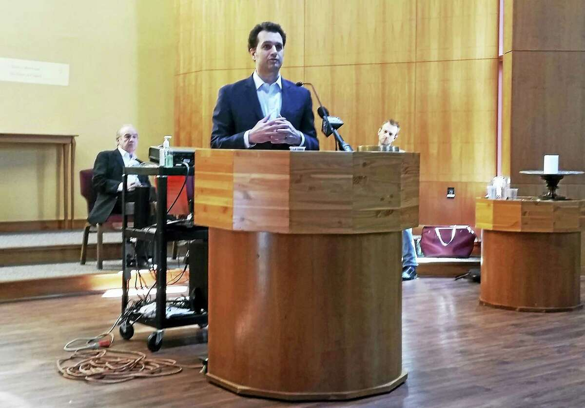 State Rep. Michael D'Agostino, D-91, speaks Sunday at a meeting of the Unitarian Society of New Haven's Preventing Gun Violence Task Force, only hours after the latest shooting in Hamden. To his left is Ron Pinciaro, executive director of Connecticut Against Gun Violence, and on the right is State Rep. Joshua Elliott, D-88.