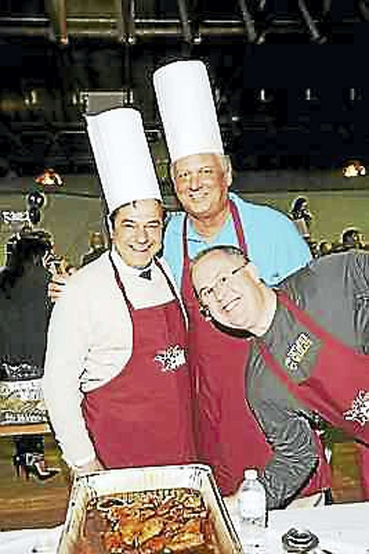 """From left, Ansonia Mayor David Cassetti, Ansonia Alderman Lorie Vaccaro and Seymour First Selectmen Kurt Miller at a previous """"Men Who Cook"""" event."""