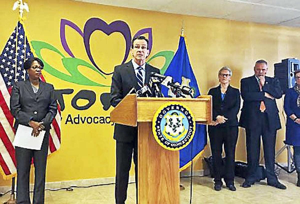 Gov. Dannel P. Malloy speaks at the podium on Thursday.