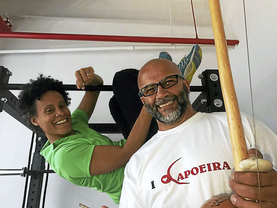 Physical fitness trainer Marannie Rawls Philippe, left, owner of Elm City Coach, and Efraim Silva, owner of Connecticut Capoeira Center, have decided to share a rented space for the businesses at 315 Peck St. in New Haven. Photo: PAMELA MCLOUGHLIN/HEARST CONNECTICUT MEDIA