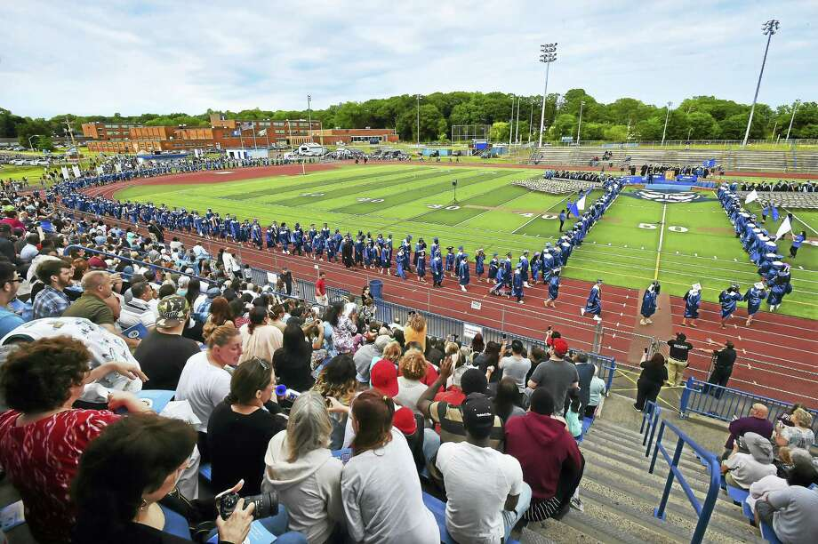 The processional of the West Haven High School class of 2017 at Ken Strong Stadium Thursday. Photo: Catherine Avalone / Hearst Connecticut Media   / Catherine Avalone/New Haven Register