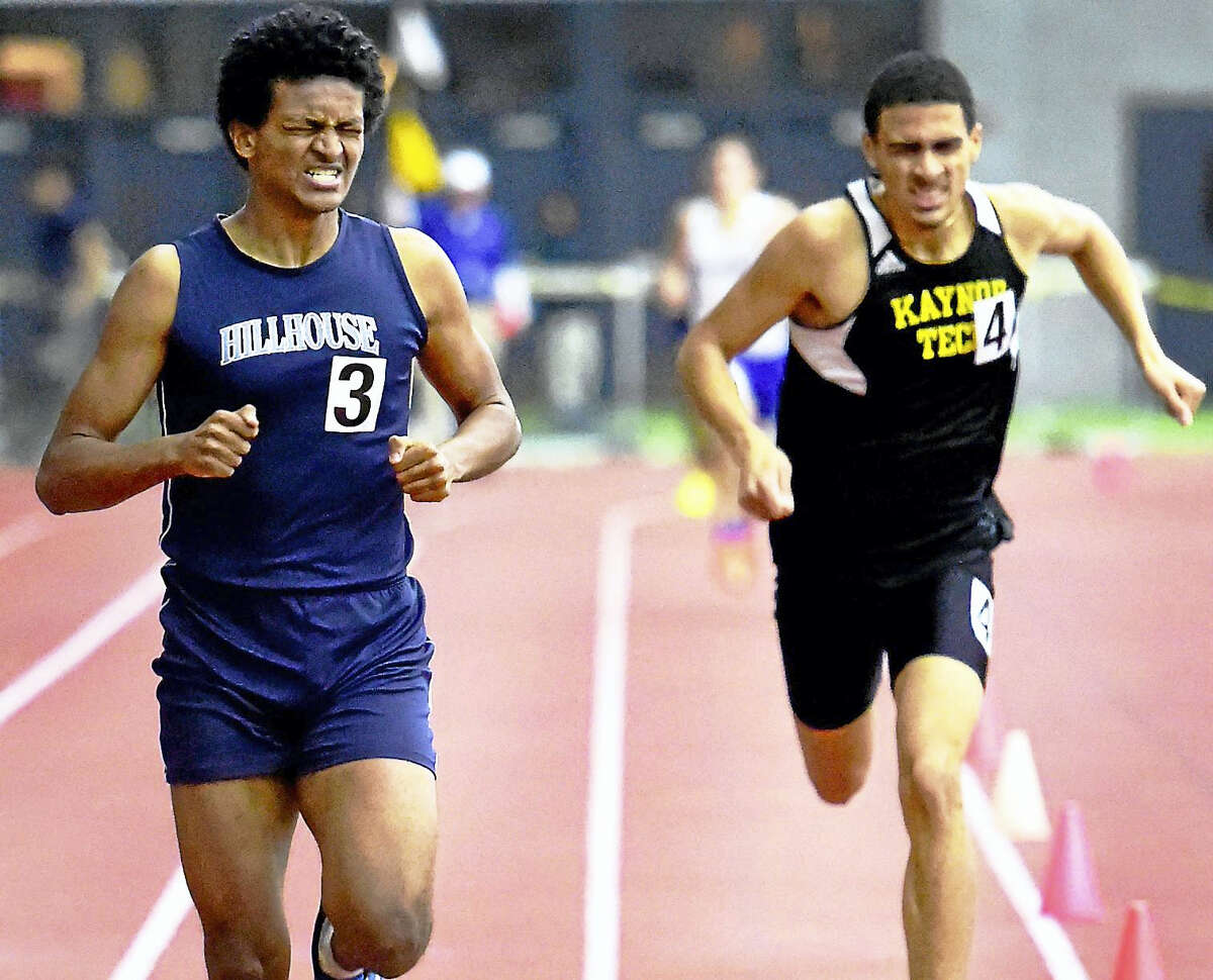 Manasseh Bekele of Hillhouse High School defeats Terrell Patterson of Kaynor Tech during the fastest heat of the 600-meter dash Monday at the Class M Indoor Track Championships at the Floyd Little Athletic Center in New Haven.