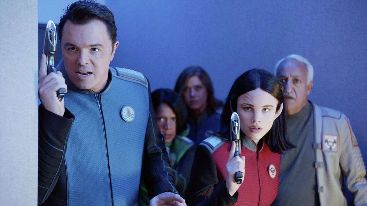 """This image provided by Fox shows Seth MacFarlane, from left, Penny Johnson Jerald, Adrianne Palicki, Halston Sage and guest star Brian George in a scene from """"The Orville"""". Fox said Monday, May 15, 2017, its schedule will include the new space adventure starring and produced by MacFarlane. The series is set 400 years ahead and follows the adventures of an exploratory spaceship."""
