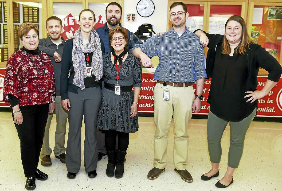 """Branford High School teachers who have received fellowships for study-travel through the non-profit Fund For Teachers Thursday, April 6, 2017, from left to right: Elise Weisenbach, Nick Rizzi, Mallory Legman, Rob Polemeni Donna Roy, Hamilton Hernandez and Jen Rice. """"Fund for Teachers strengthens instruction by investing in outstanding teachers' self-determined professional growth and development in order to support student success, enrich their own practice, and strengthen their schools and communities,"""" according to the Fund for Teachers website."""