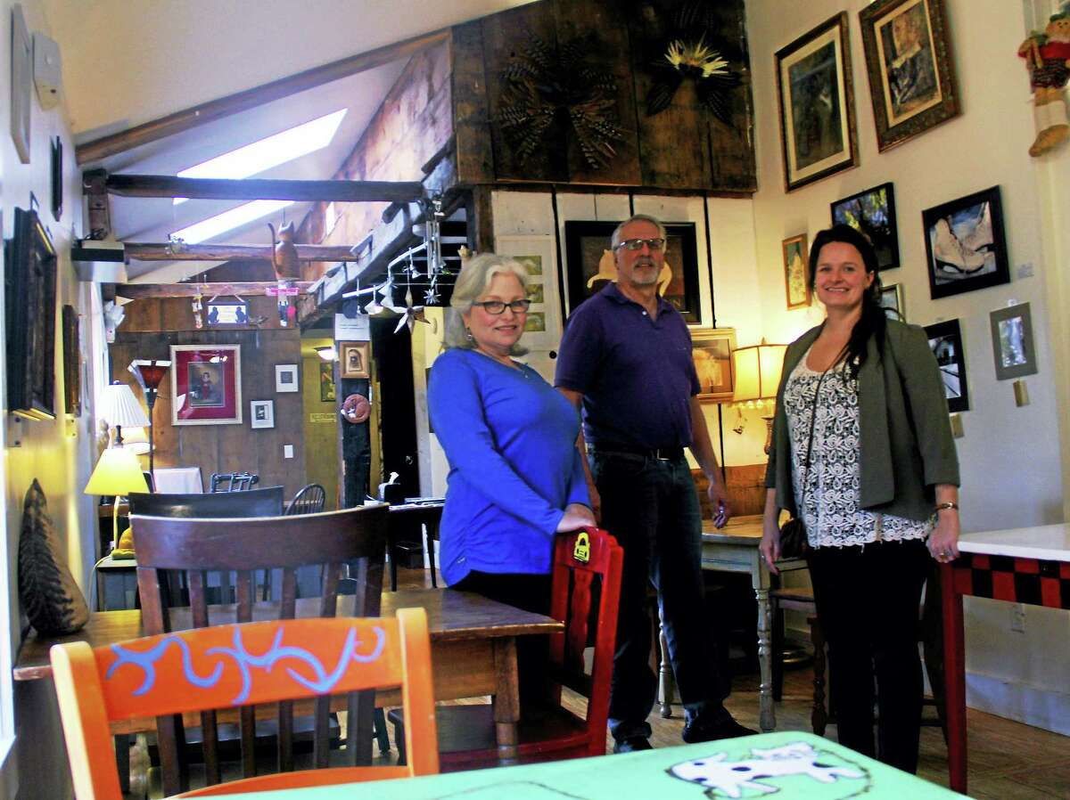 From left: East Haddam residents Colleen Shaddox and Theresa Govert join owner Mark Thiede in a uniquely decorated room at Two Wrasslin Cats Coffee House, in East Haddam.