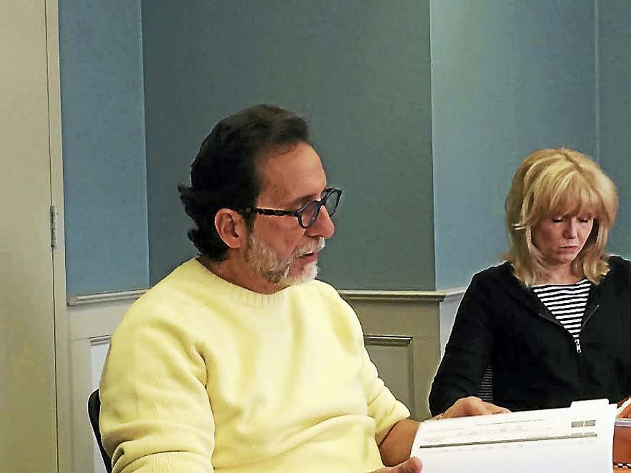 Cheshire Town Manager Michael Milone, left, discusses his proposed budget during a press conference Friday morning. The town's Public Information Arnett Talbot is at right. Photo: Luther Turmelle -—New Haven Register