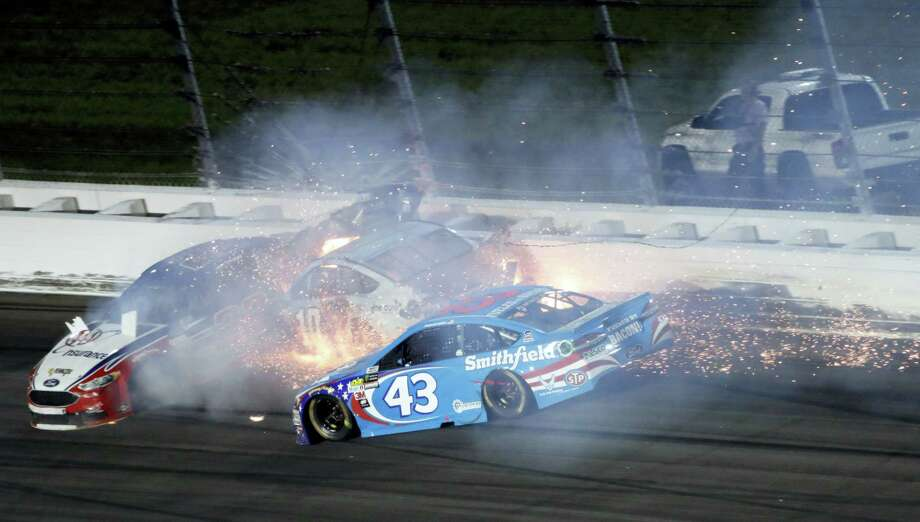 Aric Almirola (43) crashes into Danica Patrick (10) and Joey Logano (22) during the NASCAR Monster Cup auto race at Kansas Speedway in Kansas City, Kan. on May 13, 2017. Photo: AP Photo — Colin E. Braley   / FR123678 AP