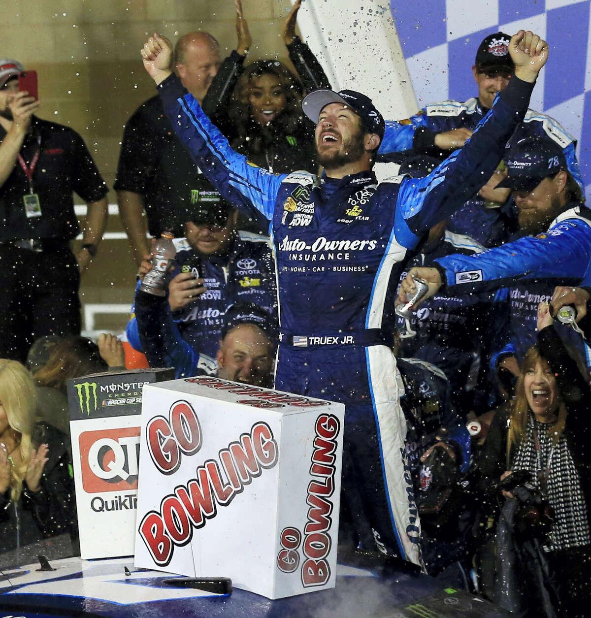 Martin Truex Jr. celebrates after winning at Kansas Speedway on Saturday night.