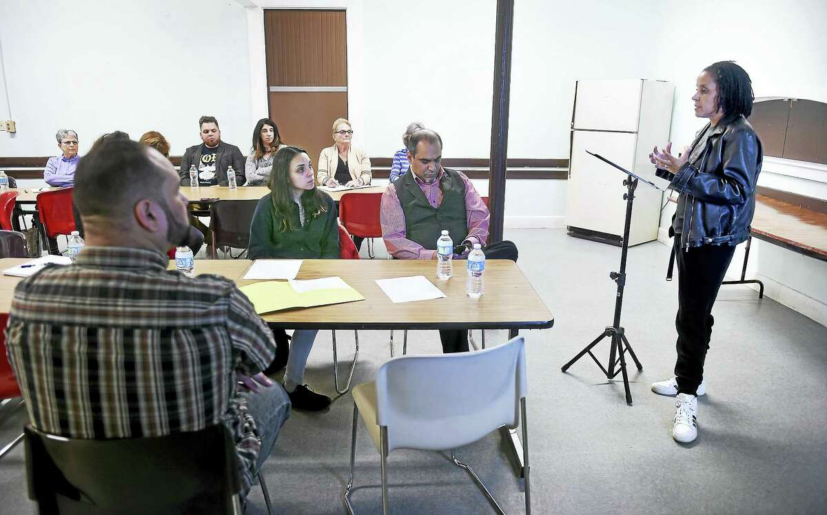 (Arnold Gold-New Haven Register) Kica Matos (right), Director of Immigrant Rights and Racial Justice at the Center for Community Change, speaks at a meeting concerning sanctuary for immigrants at Iglesia de Dios Pentecostal Church in New Haven on 4/9/2017.
