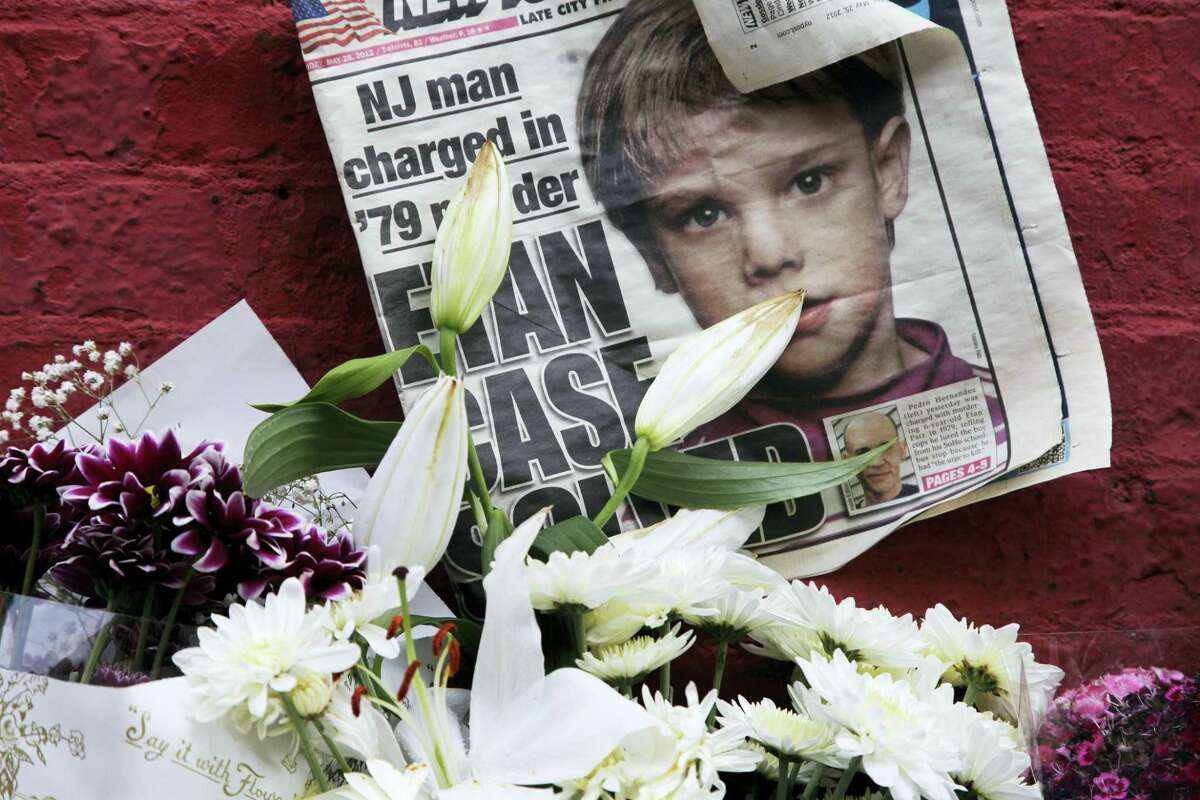 A newspaper with a photograph of Etan Patz is part of a makeshift memorial in the SoHo neighborhood of New York in 2012.