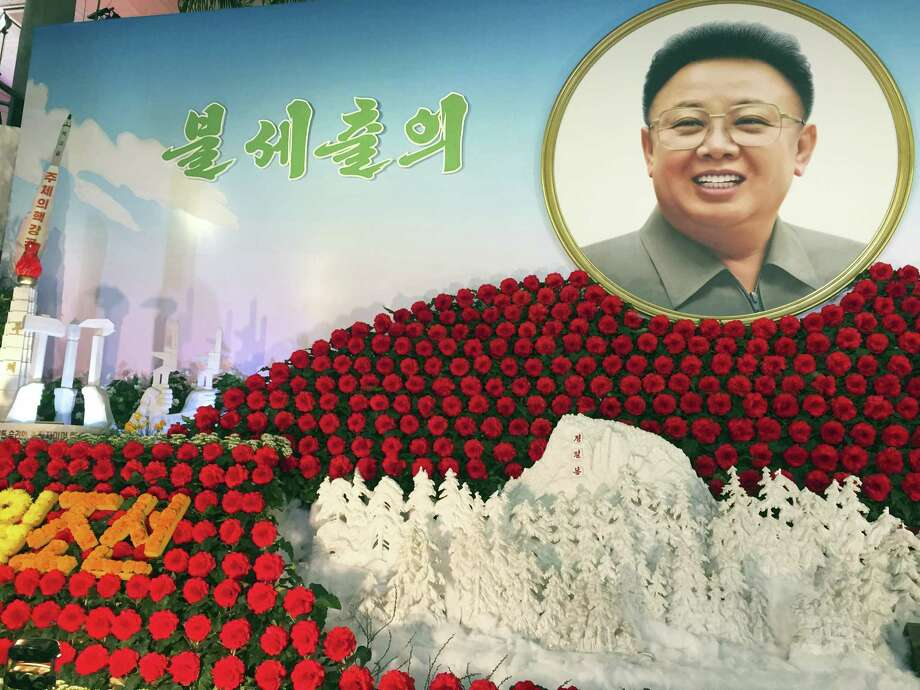 A portrait of the late North Korean leader Kim Jong Il and a depiction of the country's newest missile, left, are displayed at a flower show marking Kim's birthday in Pyongyang, North Korea on Feb. 14, 2017. Photo: Eric Talmadge — AP Photo   / AP