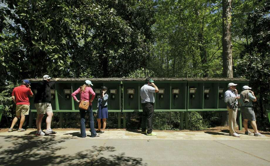 Patrons use pay phones on the Augusta National golf course Saturday in Augusta, Ga. No cell phones are allowed on the course. Photo: Charlie Riedel — The Associated Press   / Copyright 2017 The Associated Press. All rights reserved.