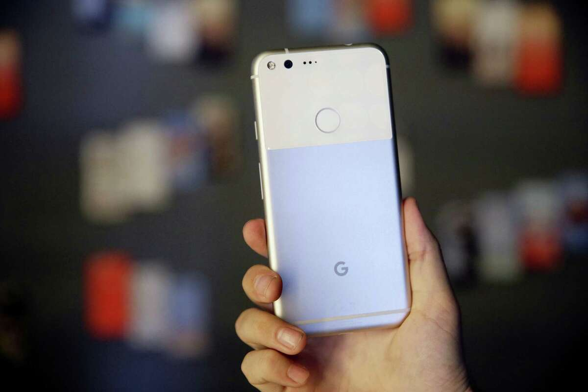 The new Google Pixel phone is displayed following a product event in San Francisco last year. Google's head-on rival to the iPhone, the Pixel, is off to a modest but promising start. It is Google's first step in what it says will be a years-long effort to take on Apple where it's strongest.