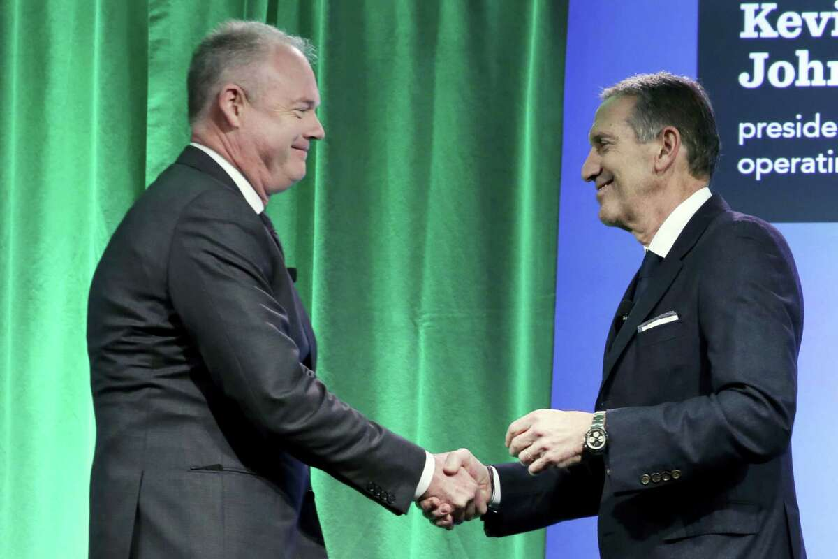 Starbucks Chairman and CEO Howard Schultz, right, introduces company President and COO Kevin Johnson during the Starbucks 2016 Investor Day meeting, in New York.