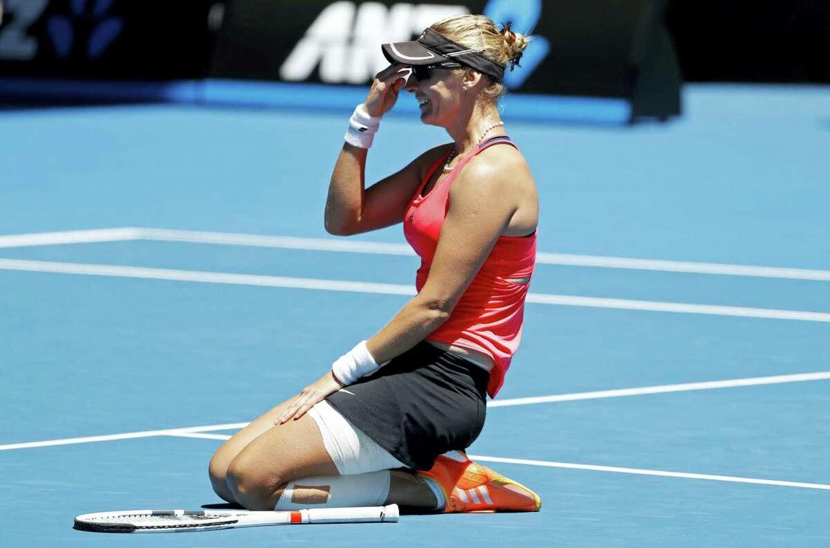 Croatia's Mirjana Lucic-Baroni celebrates after defeating Karolina Pliskova of the Czech Republic during their quarterfinal at the Australian Open tennis championships in Melbourne, Australia on Jan. 25, 2017.