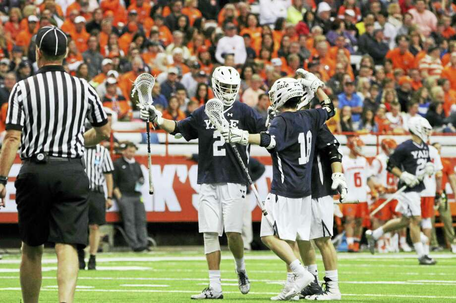 Yale's Ben Reeves (2) celebrates after scoring against Syracuse during their NCAA tournament game. Reeves set the school record for all-time career points on Sunday. Photo: Photo Courtesy Of Yale Athletics
