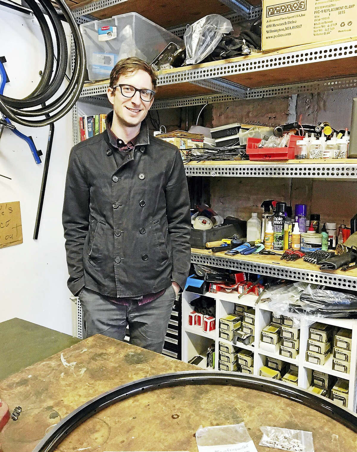 John Martin of the Bradley Street Bicycle Co-op is open for business three days a week repairing bikes.Mary O'Leary - New Haven Register