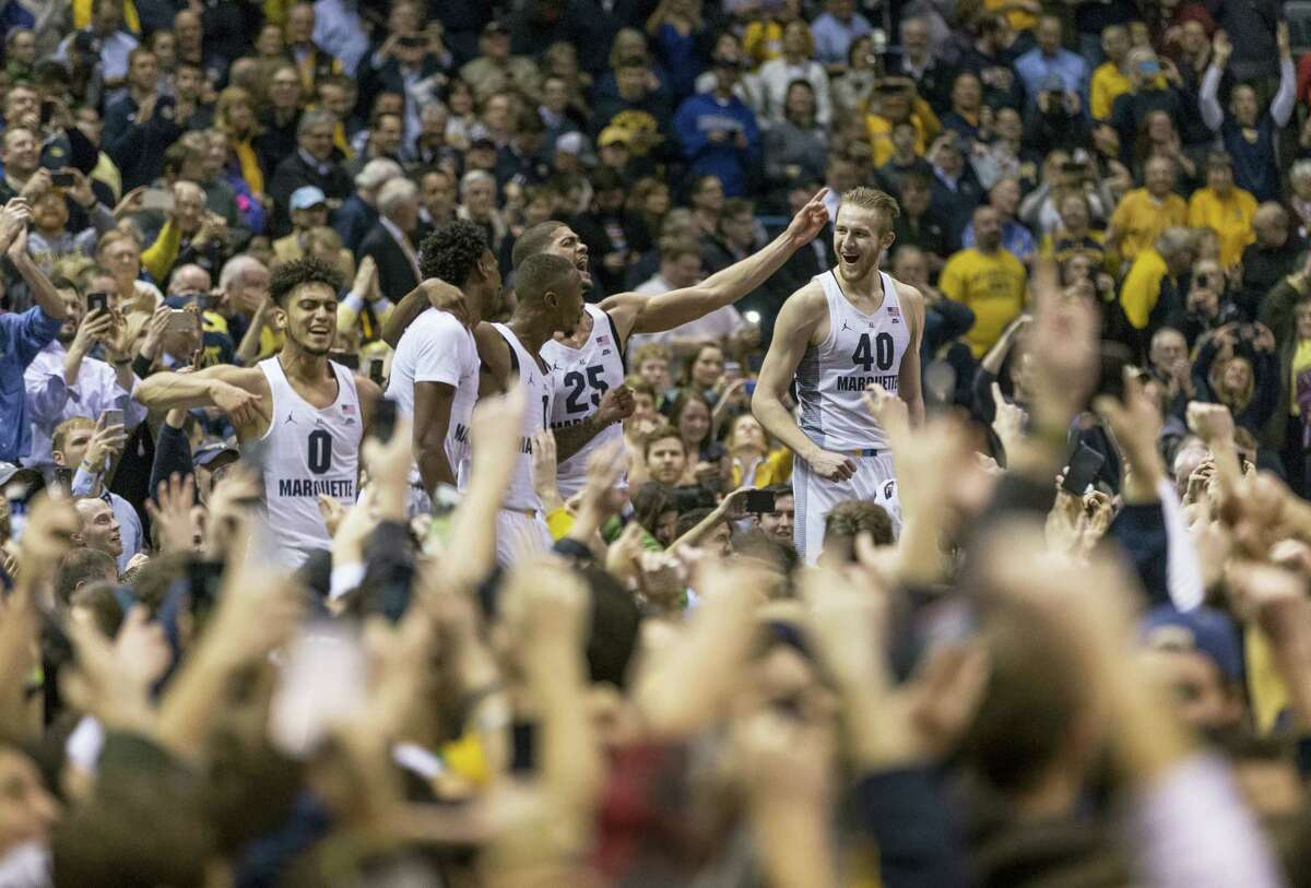 Marquette fans storm the court after defeating number one ranked Villanova in an NCAA college basketball game on Jan. 24, 2017 in Milwaukee. Marquette defeated Villanova 74-72.