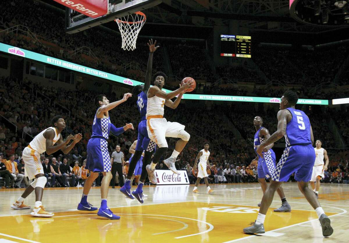 Tennessee guard Robert Hubbs III (3) goes for a shot past Kentucky forward Wenyen Gabriel (32) during the first half of an NCAA college basketball game on Jan. 24, 2017 in Knoxville, Tenn.