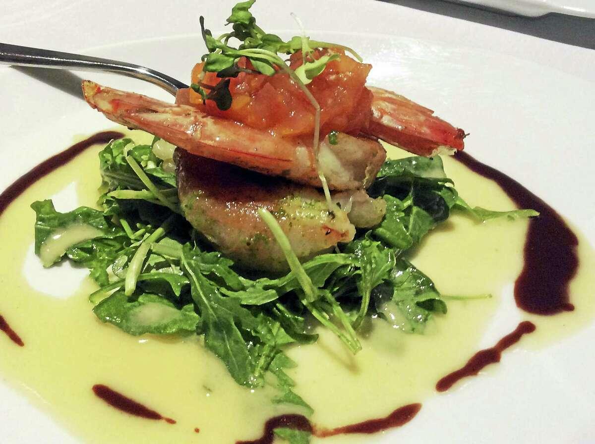 Sea Guini's gamberetti (prosciutto di parma-wrapped jumbo shrimp, arugula, bruschetta tomatoes, tangy balsamic, lemon burro sauce).