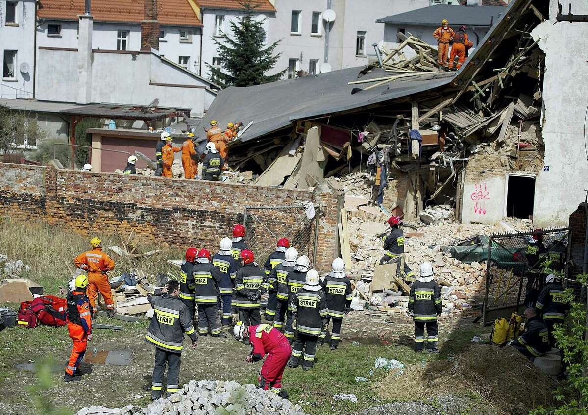 Rescuers and firefighters search for 11 missing people in the rubble of an apartment house that collapsed in Swiebodzice, Poland, on Saturday, April 8, 2017. Firefighters suspect the collapse might have been caused by a gas explosion. Several people were killed and injured.