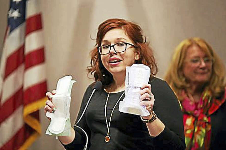 Rep. Kelly Luxenberg, D-Manchester, holds up a sanitary pad and an incontinence pad last March. Photo: Ctnewsjunkie File Photo
