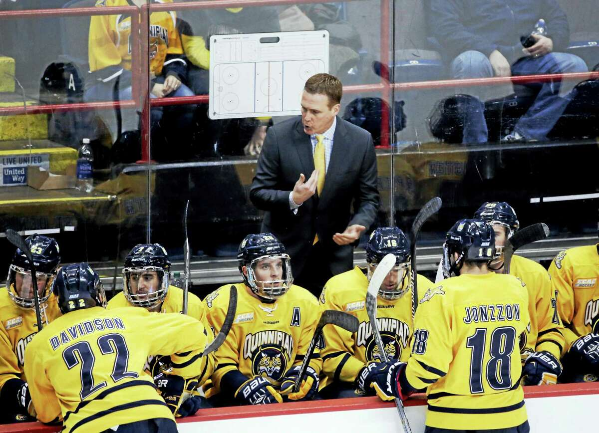 Quinnipiac head coach Rand Pecknold talks to players during the first period of the NCAA men's East Regional championship hockey game against UMass Lowell last March in Albany, N.Y. The Bobcats are 13-10-2, but ranked 19th in the nation.