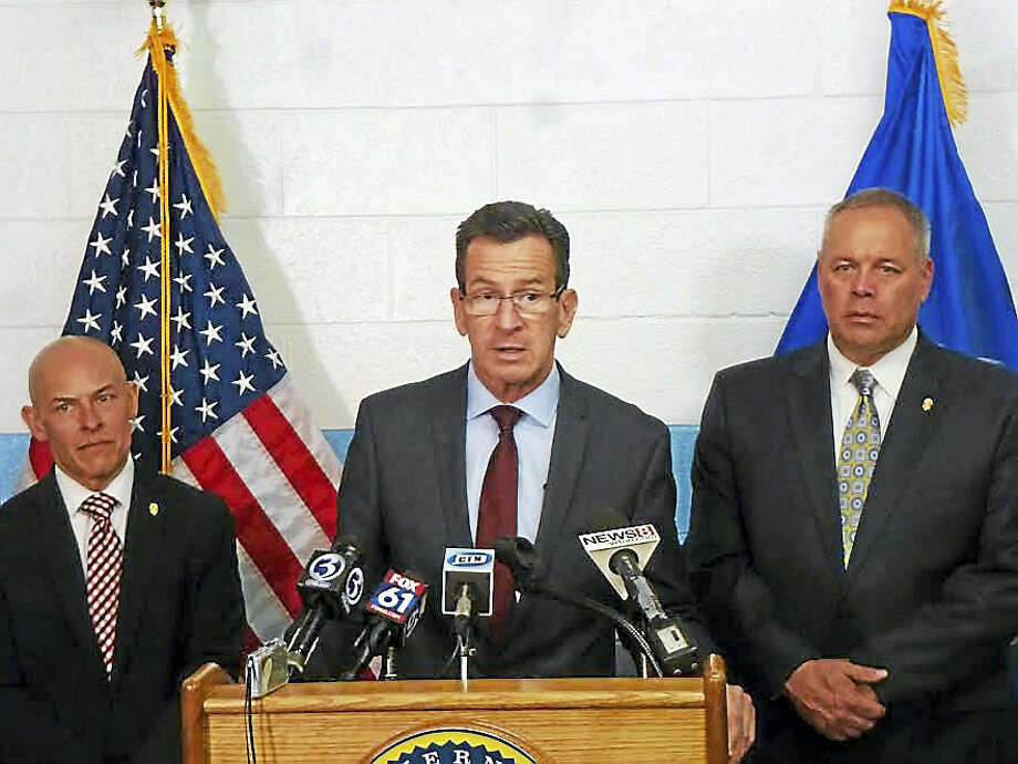 From left, Warden Jose Feliciano, Gov. Dannel P. Malloy and Commissioner Scott Semple introduce the new program at New Haven Correctional Center. Photo: Ryan Flynn — New Haven Register/file