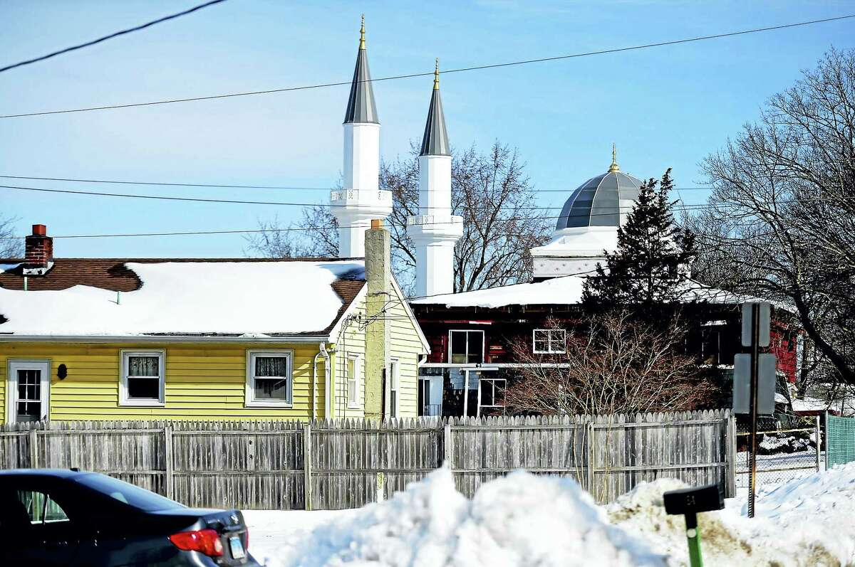 The Mosque at 531 Middletown Ave. in New Haven Tuesday as seen from the corner of Weybosset Street and Ellis Street in New Haven Tuesday. The two minarets are 24 feet tall and over the height limit agreed. City officials say it is up to the mosque owner, the Turkish-American Religious Foundation, to make the 81-foot tall towers smaller.