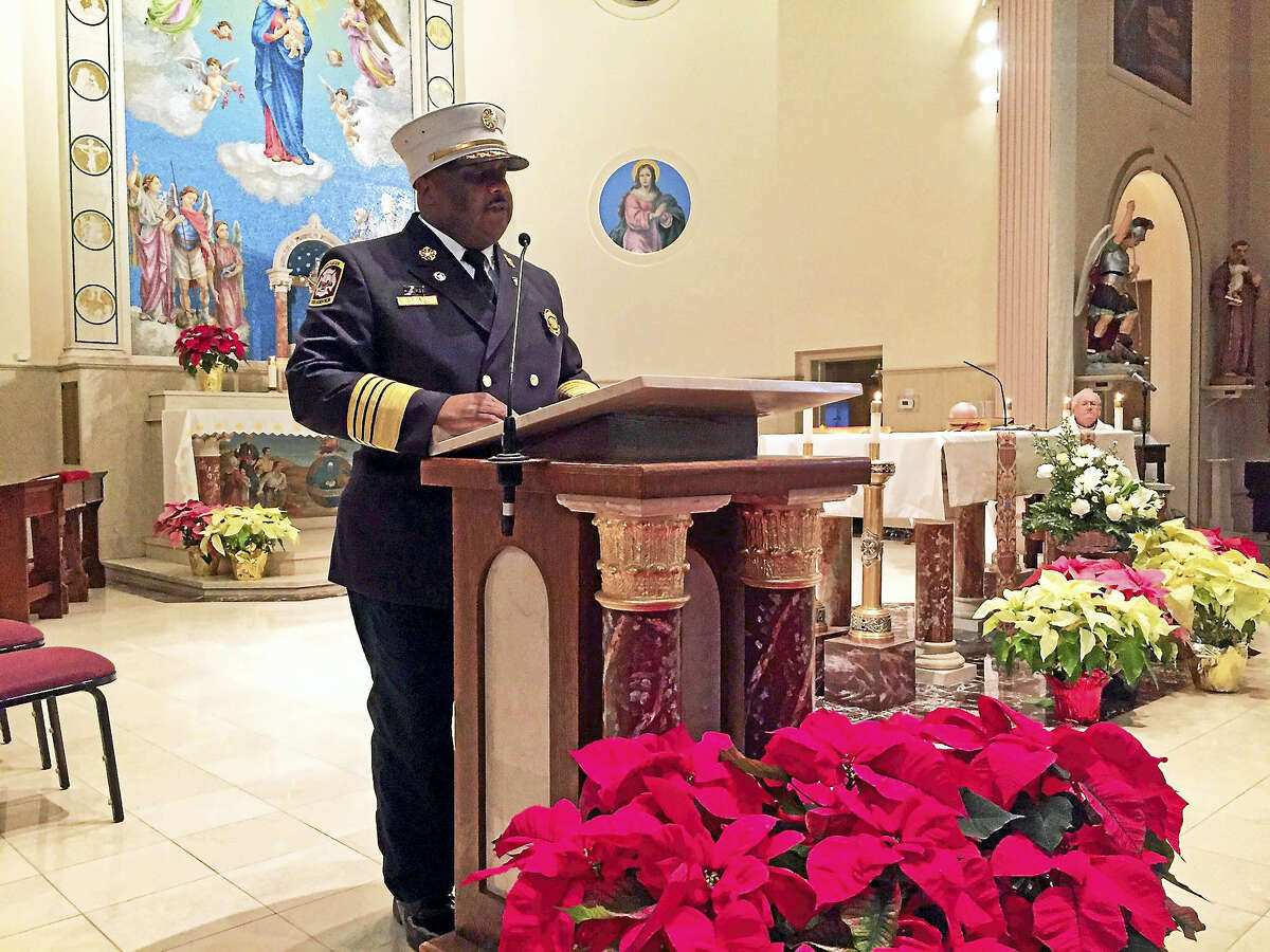 New Haven Fire Chief John Alston Jr. spoke Tuesday at a Mass at the Church of St. Michael to remember those who died Jan. 24, 1957, in a devestating fire on Franklin Street.
