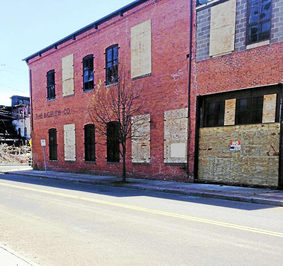The site of 198 River St. where Capasso Restoration is expected to stabilize four buildings and later renovate them. They are part of the former Bigelow Boiler plant. Photo: Mary O'Leary — New Haven Register