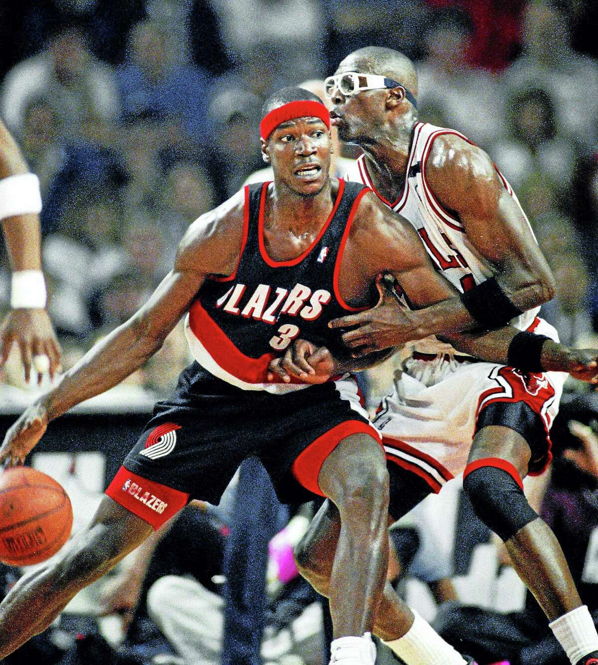 In this June 4, 1992 photo, Portland Trail Blazers' Cliff Robinson drives on Chicago Bulls' Horace Grant during Game 1 of the NBA Finals in Chicago.