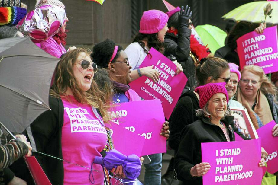 Marchers outside New Haven City Hall during a Nasty Women march on Saturday that concluded with organizers delivering a check to Planned Parenthood of Southern New England. Photo: Esteban L. Hernandez — New Haven Register