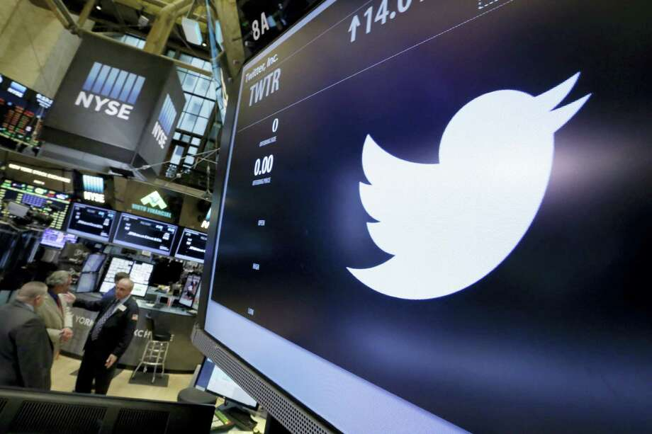 The symbol for Twitter appears above its trading post on the floor of the New York Stock Exchange. Photo: Richard Drew — AP File Photo   / Copyright 2016 The Associated Press. All rights reserved. This material may not be published, broadcast, rewritten or redistribu