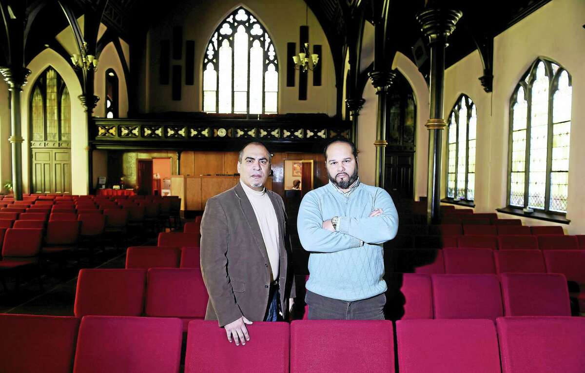 The Rev. Abraham Hernandez, left, executive director for the National Hispanic Christian Leadership Conference, is photographed with the Rev. Hector Otero at Iglesia de Dios Pentecostal in the Fair Haven section of New Haven.