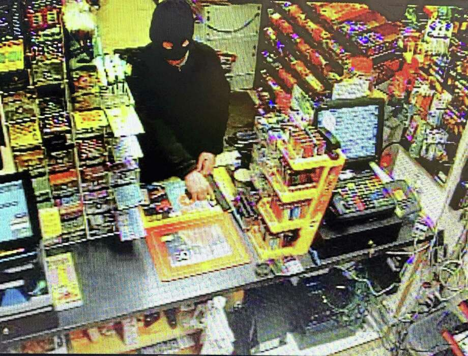 North Haven police are looking for an armed, masked man who allegedly robbed the Shell gas station at 195 State St. late Tuesday. Photo: Photo Courtesy Of The North Haven Police Department