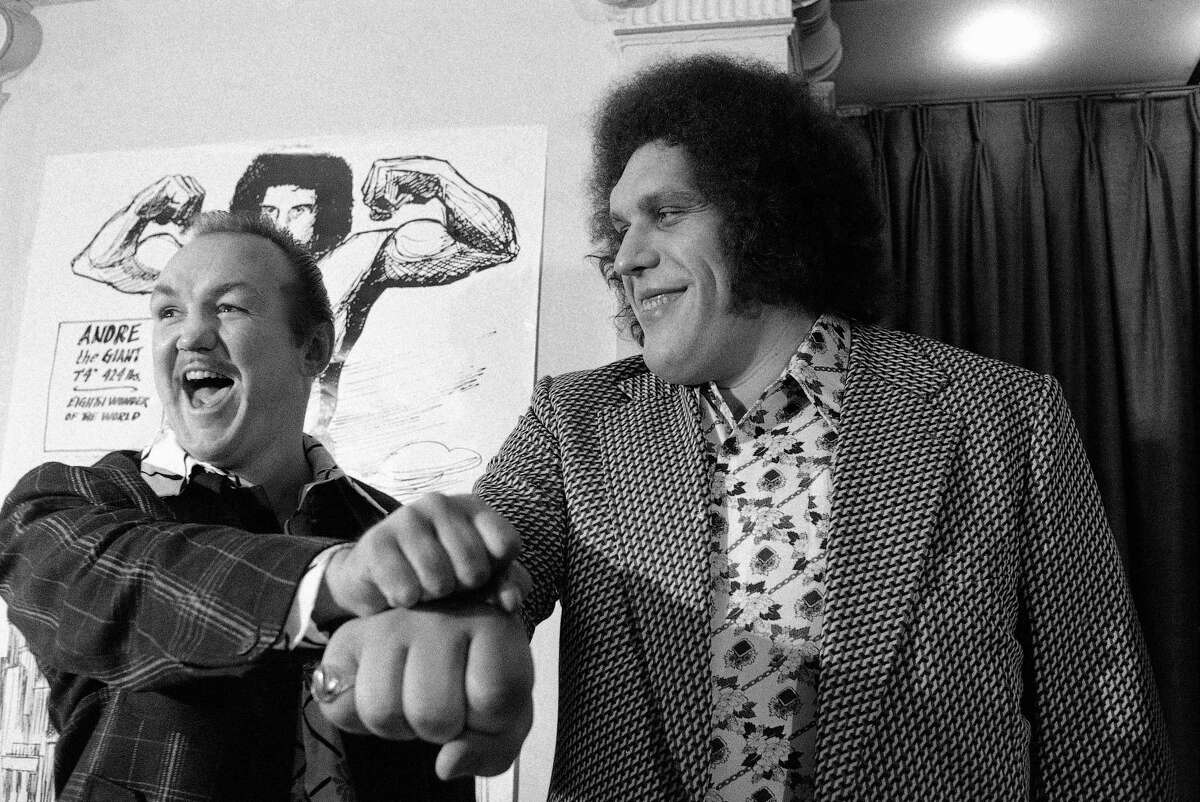 """In this 1976 photo, heavyweight boxer Chuck Wepner, left, compares fists with professional wrestler Andre The Giant in New York. HBO Sports, and the Bill Simmons Media Group will produce """"Andre The Giant,"""" a documentary film examining the life and career of one of wrestling's biggest stars."""
