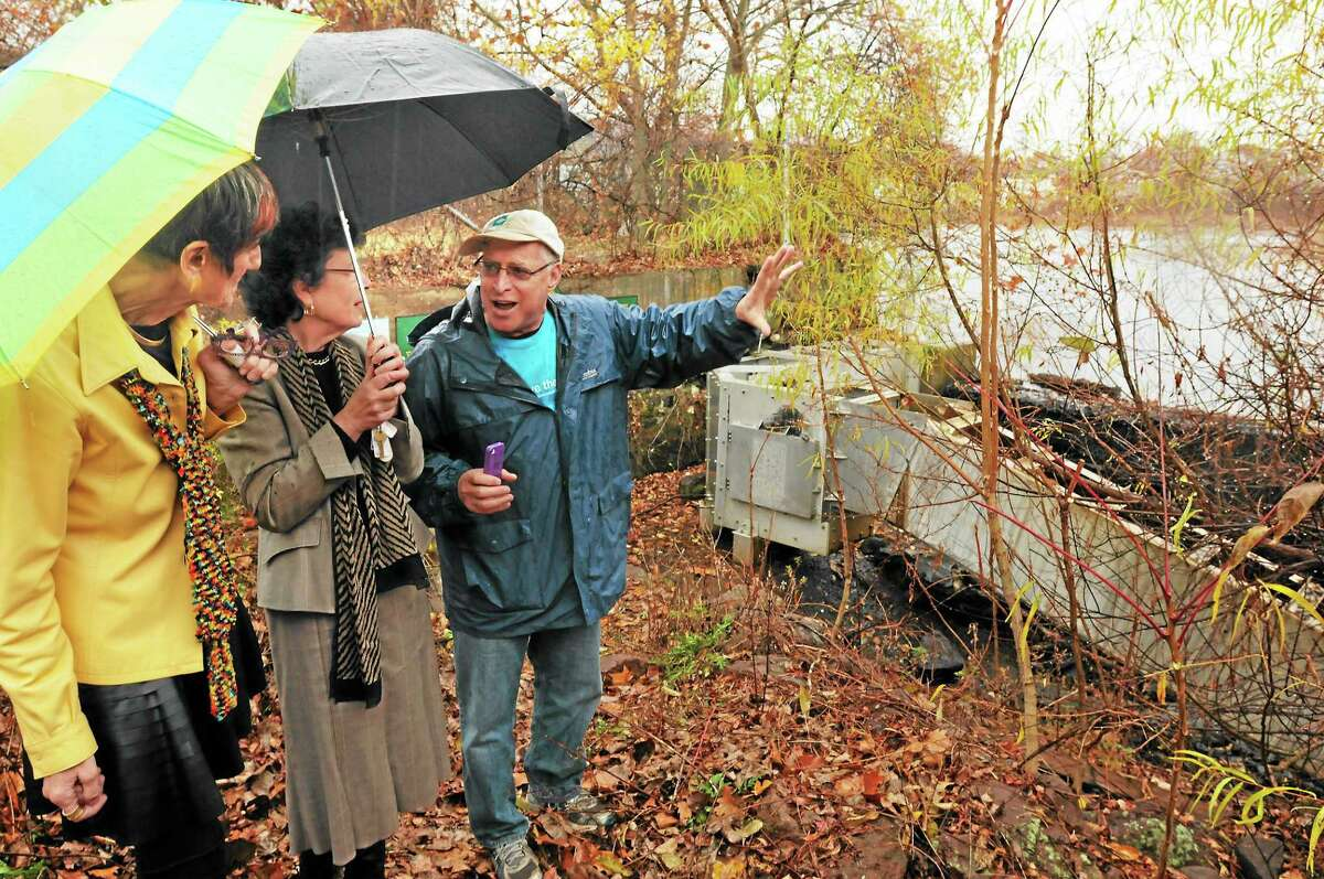 At the he 18th century dam on the West River, usually called the Pond Lily Dam, U.S. Rep. Rosa DeLauro, D-3, and Woodbridge First Selectwoman Ellen Scalettar get an overview of the site from CT Fund for the Environment's John Champion. The dam removal process began in 2015 and is now complete.