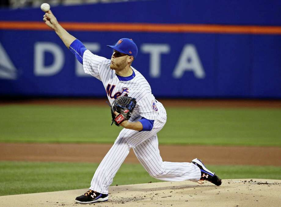 Mets starter Zack Wheeler delivers a pitch during the first inning on Friday. Photo: Frank Franklin II — The Associated Press   / Copyright 2017 The Associated Press. All rights reserved.