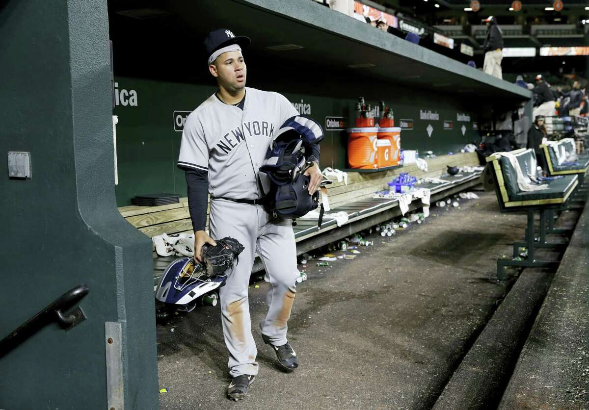Yankees catcher Gary Sanchez walks out of an empty dugout after Friday's loss to the Orioles..