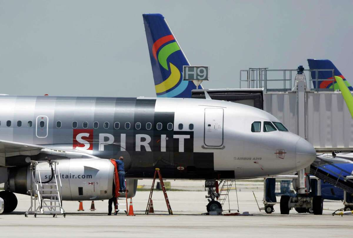 A Spirit Airlines airplane sits on the tarmac at Fort Lauderdale-Hollywood International Airport in Fort Lauderdale, Fla.