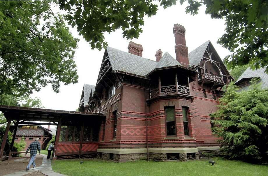 """In this June 4, 2008, file photo, visitors enter The Mark Twain House and Museum in Hartford, Conn. Notes that Twain jotted down from a fairy tale he told his daughters more than a century ago when living in Hartford, Conn., have inspired a new children's book, """"The Purloining of Prince Oleomargarine,"""" set to be published in September 2017. The contract for the book was steered through the Mark Twain House and Museum in Hartford as a way to provide a financial lift for the museum. Photo: AP Photo/Jessica Hill, File    / AP2008"""