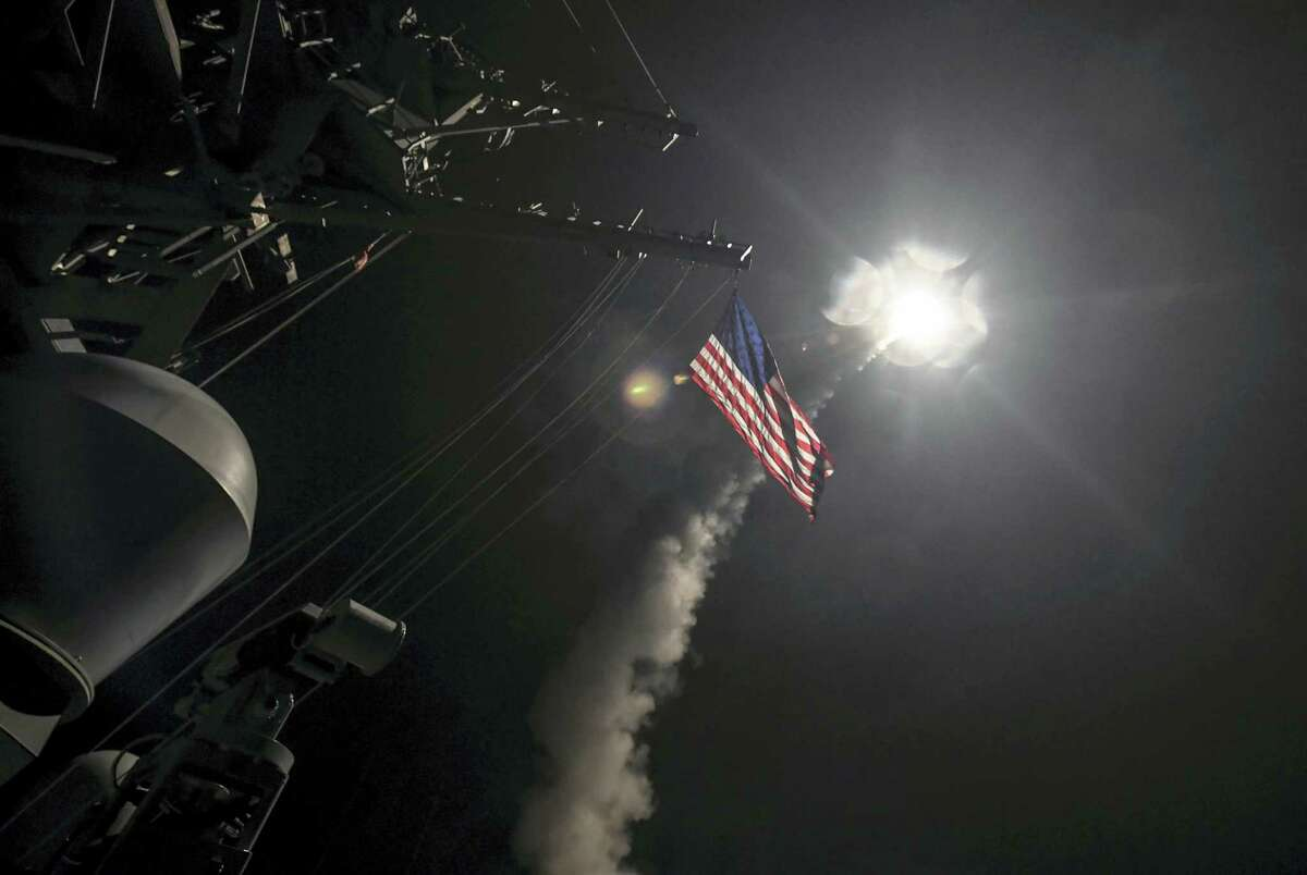 In this image provided by the U.S. Navy, the guided-missile destroyer USS Porter (DDG 78) launches a tomahawk land attack missile in the Mediterranean Sea, Friday, April 7, 2017. The United States blasted a Syrian air base with a barrage of cruise missiles in fiery retaliation for this week's gruesome chemical weapons attack against civilians.