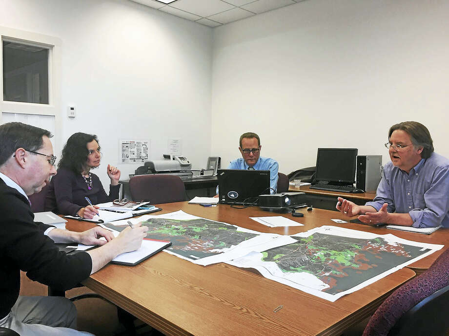 Doug Royalty, right, speaks with Branford officials about historical sites in Branford that could be at risk in the event of sea level rise or storms similar to Superstorm Sandy. Photo: Anna Bisaro — New Haven Register