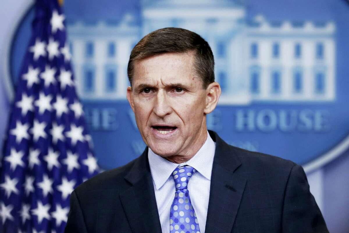 """In this Feb. 1, 2017 photo, National Security Adviser Michael Flynn speaks during the daily news briefing at the White House, in Washington. President Donald Trump has yet to comment on the allegations that Flynn engaged in conversations with a Russian diplomat about U.S. sanctions before Trump's inauguration. A top aide dispatched to represent the administration on the Sunday, Feb. 12 news shows skirted questions, saying it was not his place to weigh in on the """"sensitive matter."""""""