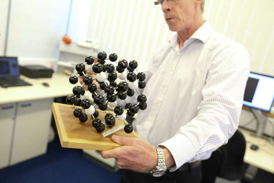 Philip Martineau, head of physics at the De Beers Research Centre, holds a molecular model of a diamond at De Beers Technologies research laboratory in Maidenhead, England, on June 30, 2015. Photo: Bloomberg Photo/Chris Ratcliffe   / © 2015 Bloomberg Finance