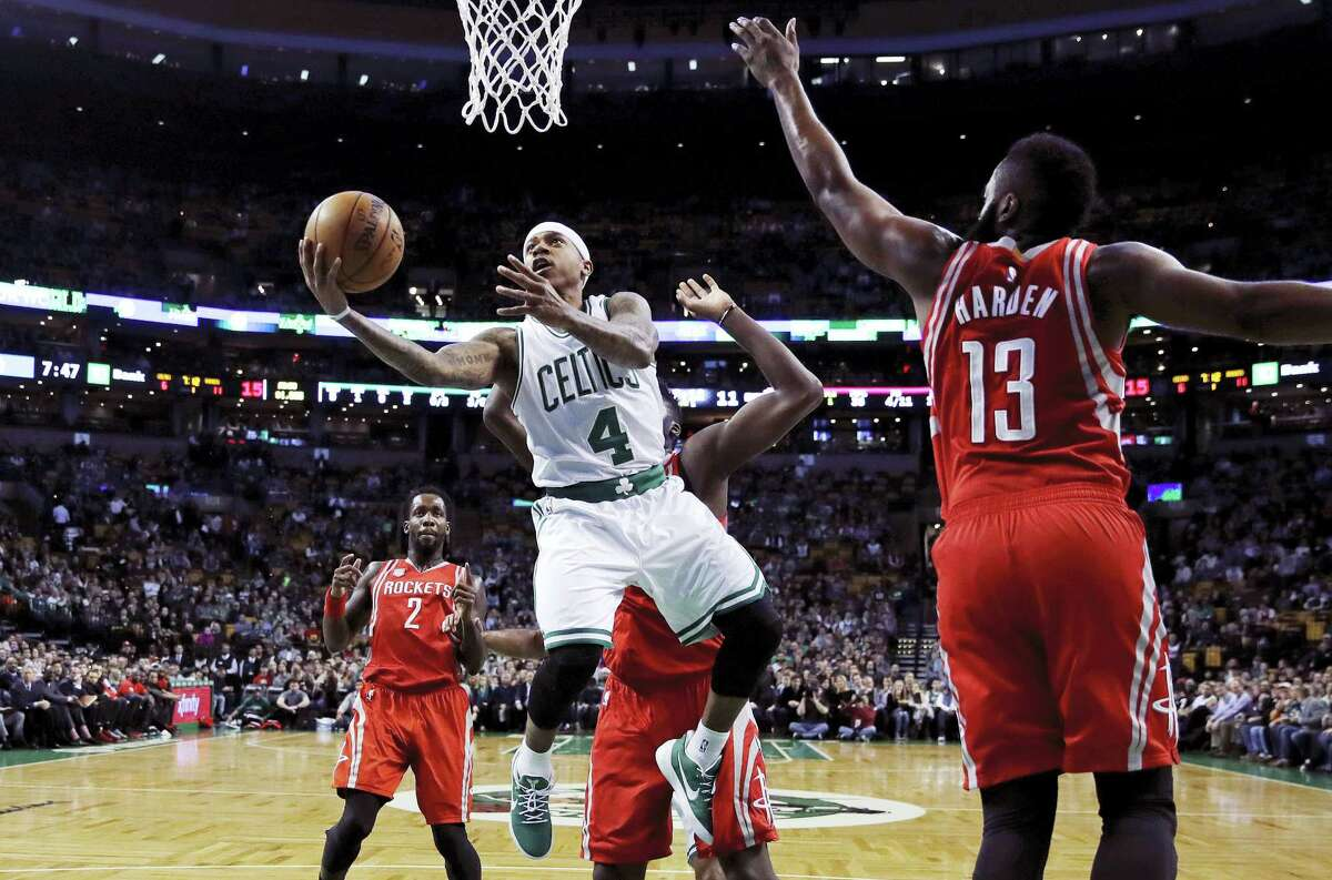 Boston Celtics guard Isaiah Thomas drives to the basket against Houston Rockets guard James Harden (13) during the first quarter in Boston, Wednesday. Thomas scored 38 points to lead the Celtics to the 120-109 victory.