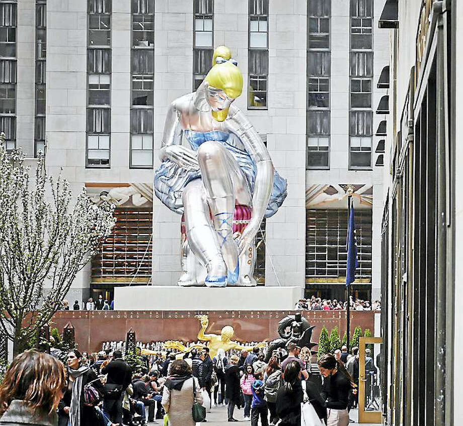 """""""Seated Ballerina"""", center, the public art exhibition of a 45-foot inflatable nylon sculpture depicting a seated ballerina from artist Jeff Koons' Antiquity series, is displayed at Rockefeller Center in New York City after it was unveiled Friday May 12, 2017. Photo: AP Photo/Bebeto Matthews    / Copyright 2017 The Associated Press. All rights reserved."""