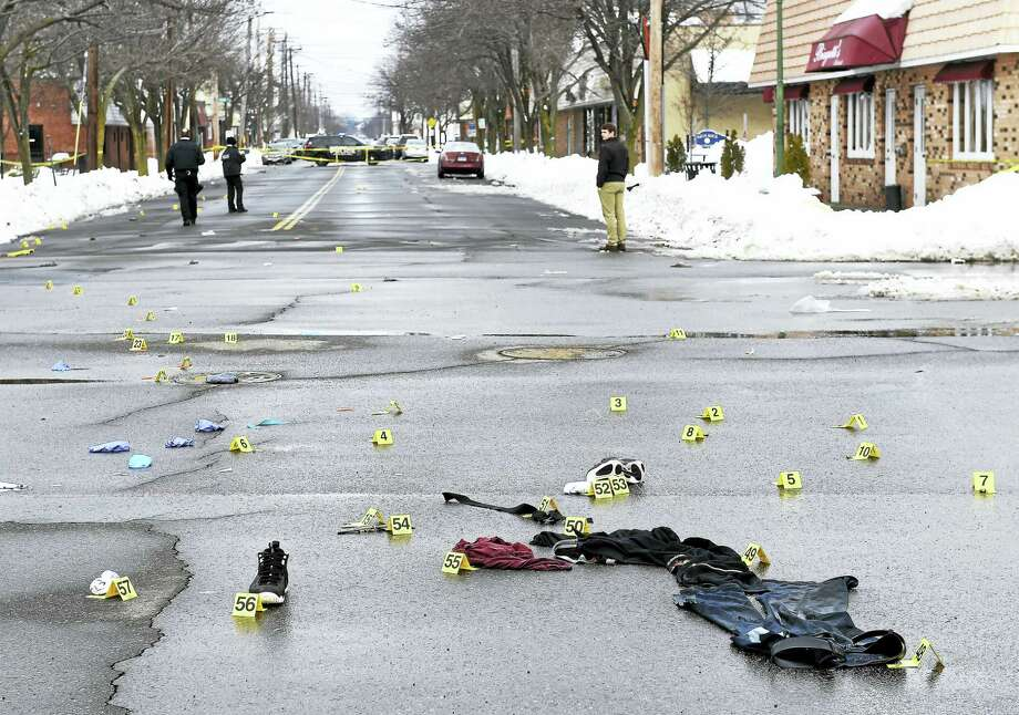 West Haven Police investigate the scene of a fatal shooting at the corner of Captain Thomas Boulevard and Campbell Ave. in West Haven on Saturday morning. Photo: Arnold Gold — New Haven Register